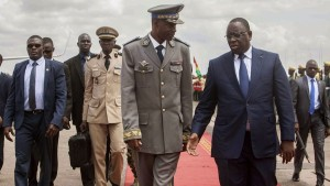 General Gilbert Dienderé with the President of Senegal, Macky Sall. (AP Photo/Theo Renaut – Keystone)