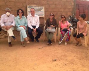 """Photo 1: This year's travelers, with María Bacardit (""""petit María""""), waiting to be received by the Naaba (the traditional leader) of Zongo."""