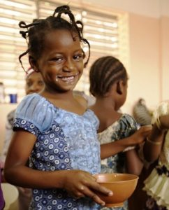 Photo 3: One of the nursery school's princesses, with a milk moustache still over her smile